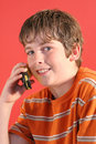 Young boy on cell phone vertic Royalty Free Stock Photo