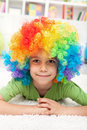 Young boy with clown wig Stock Photography