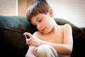 Young boy with diabetes school aged injecting insulin Stock Photo