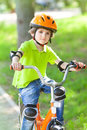 The young boy drives bike in summer park Stock Photography