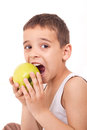 Young boy eating apple Stock Photos