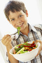 Young Boy Eating A Healthy Salad Stock Image