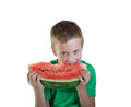 Young boy eating red melon Royalty Free Stock Photo