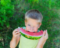 Young boy eating watermelon Stock Photo