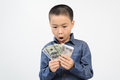 Young boy excite with bank note excitewith american and korean in his hand Stock Image