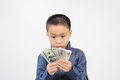 Young boy excite with bank note excitewith american and korean in his hand Stock Photo