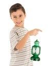 Young boy feeling happy with Ramadan lantern