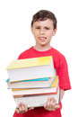 Young boy feeling tired from carrying many books Royalty Free Stock Photo