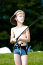 Young boy fishing at a lake Royalty Free Stock Image
