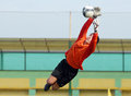 Young boy football or soccer goalkeeper jump parade jumps after a ball during a game the game was played during sports days of Royalty Free Stock Photography
