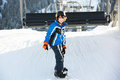 Young Boy Getting Off Chair Lift On Ski Holiday Royalty Free Stock Photo