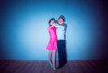 The young boy and girl posing at dance studio