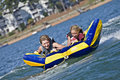 Young Boy and Girl Riding a Tube on Water Royalty Free Stock Images