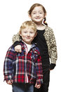 Young boy and girl smiling casually dressed on white background Stock Photo