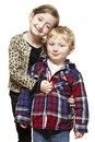 Young boy and girl smiling on white background Stock Image