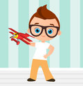 Young Boy with glasses and toy plane. Boy playing with airplane. Vector illustration eps 10 isolated on white background. Flat car Royalty Free Stock Photo