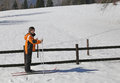 Young boy goes on cross country skiing pretty the white snow in the mountains in winter Royalty Free Stock Photos