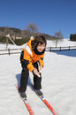 Young boy goes on cross country skiing pretty the white snow in winter Stock Image