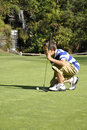Young boy golfing Stock Photo