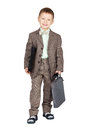 Young boy in grey suit and bow tie standing and looking on camer Royalty Free Stock Photo