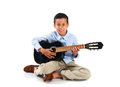 Young boy with a guitar on white background isolated Royalty Free Stock Photo