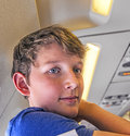 Young boy is happy arriving with the aircraft after a long flight Stock Photo