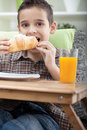 Young boy having breakfast cute little delicious Stock Photo