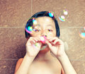 Young boy having fun with bubbles Stock Photos