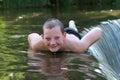Young boy having fun in the river Stockfotos
