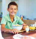 Young boy having a healthy breakfast at home Royalty Free Stock Photos