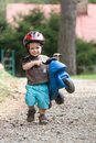 Young boy with helmet and children's bike Stock Image