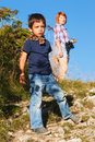 Young boy hiking with his mother astonished is looking at the view when Stock Photo
