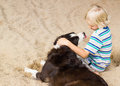 Young boy with his arm around his dog Royalty Free Stock Photo