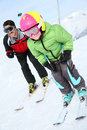 Young boy with his father skiing daddy down ski slope Royalty Free Stock Image