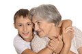 Young boy and his grandmother cheerful on a white background Royalty Free Stock Images