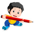 Young boy holding a big pencil Royalty Free Stock Photo