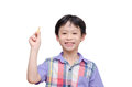 Young boy holding chalk and smiles Royalty Free Stock Photo