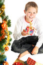 Young boy holding christmas present Stock Photo