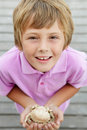 Young boy holding crab on beach Royalty Free Stock Photo