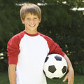 Young boy holding a football Royalty Free Stock Photo