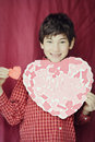Young Boy Holding Heart Royalty Free Stock Photo