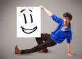 Young boy holding smiley face drawing handsome Stock Image