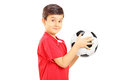Young boy holding a soccer ball isolated on white background Royalty Free Stock Photo