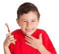 Young boy holding teeth brush happily isolated on white background Stock Images