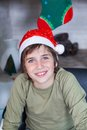 Young boy home wear red christmas santa hat sitting at happy smile Stock Photo