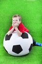 Young boy with huge soccer ball Stock Photography
