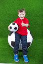 Young boy with huge soccer ball Royalty Free Stock Images