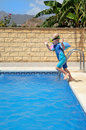Young boy jumping into pool Stock Photography
