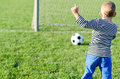 Young boy kicking a soccer ball Royalty Free Stock Photo