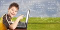 Young boy with laptop computer. Royalty Free Stock Photo
